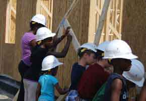 Volunteers building a house CARE House of Oakland County