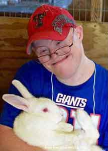 Child with rabbit Goodwill Easter Seals of the Gulf Coast
