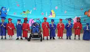 Children at graduation @ Goodwill Easter Seals Nonprofit - Mobile, Alabama