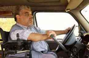 Special needs man driving a truck.