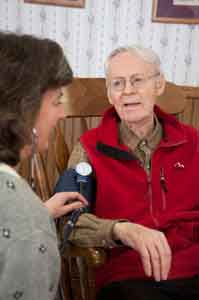 Client getting blood pressure checked at Sisters of Providence Health System
