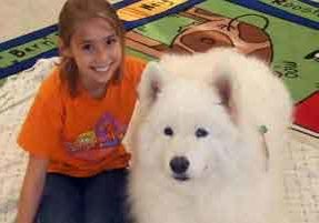 Reading with furry dog friends at Greenwood Public Library